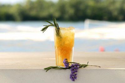 orange-cocktail-glass-with-flower-decor_99004-316
