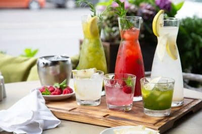 summer-soft-drinks-set-lemonades-lemonades-jugs-table-ingredients-which-they-are-made-are-arranged-around_124865-68