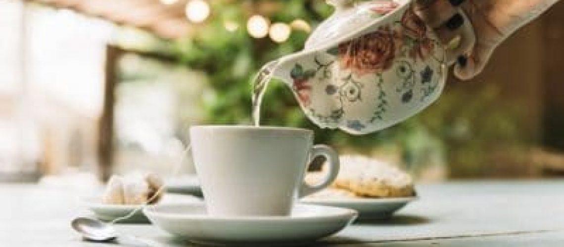 hand-serving-tea_23-2147985088