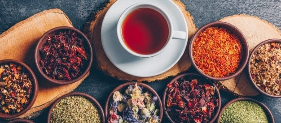 set-wood-stubs-cup-tea-tea-herbs-bowls-dark-textured-background-flat-lay_176474-5213