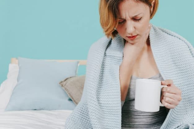 woman-with-cup-feeling-sick_23-2147768329